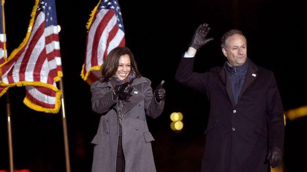 PHOTO: Sen. Kamala Harris and her husband Doug Emhoff take the stage during a drive-in get out the vote rally, Nov. 2, 2020, in Philadelphia. (Michael Perez/AP, FILE)