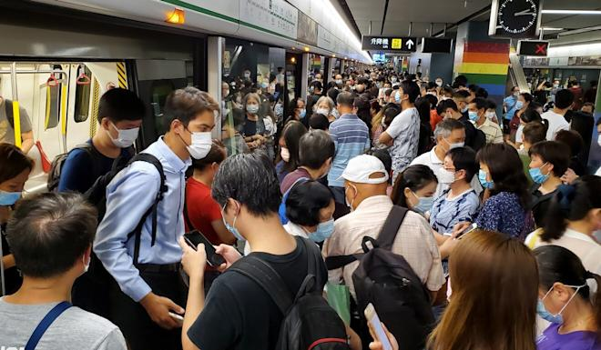 Choi Hung MTR station is packed with commuters after train services were temporarily suspended. Photo: Edmond So