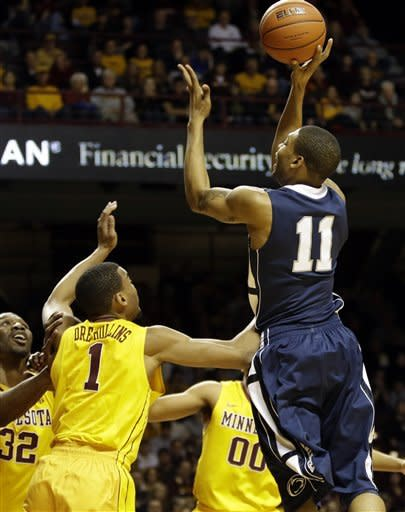 Penn State's Jermaine Marshall, right, takes a shot over Minnesota's Andre Hollins in the first half of an NCAA college basketball game, Saturday, March 2, 2013, in Minneapolis. (AP Photo/Jim Mone)