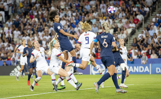 Wendie Renard of France scores his team's first goal during the 2019 FIFA Women's World Cup France Quarter Final match between France and USA at Parc des Princes on June 28, 2019 in Paris, France. (Photo by TF-Images/Getty Images)