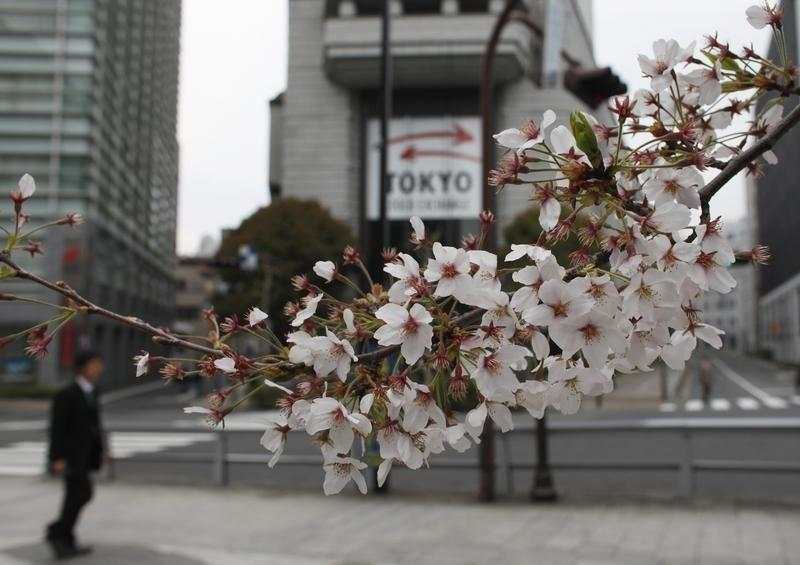 FILE PHOTO - Cherry blossoms are seen in front of the Tokyo Stock Exchange building in Tokyo April 11, 2012. REUTERS/Toru Hanai