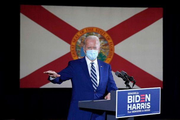 PHOTO: The Florida state flag is shown behind Democratic presidential candidate former Vice President Joe Biden as he speaks at Southwest Focal Point Community Center in, Pembroke Pines, Fla., Oct. 13, 2020. (Carolyn Kaster/AP)