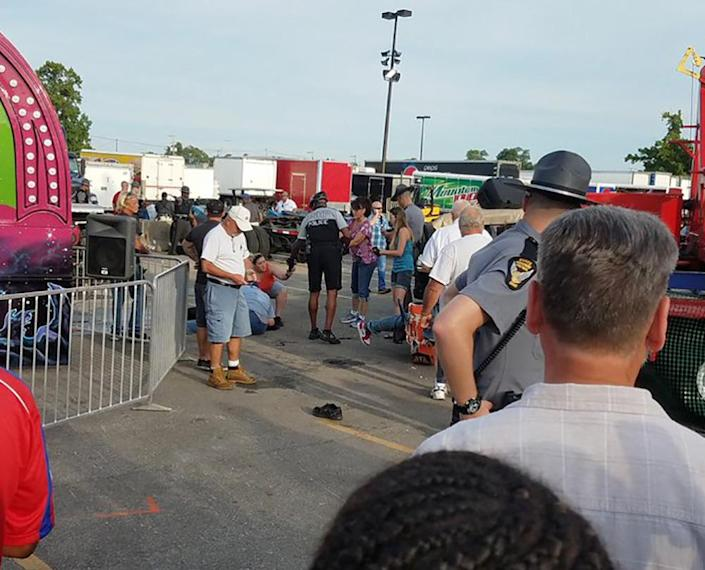 <p>A person is attended to as authorities respond after the Fire Ball amusement ride malfunctioned injuring several at the Ohio State Fair, Wednesday, July 26, 2017, in Columbus, Ohio. Columbus Fire Battalion Chief Steve Martin said that some of the victims were thrown from the ride when it malfunctioned Wednesday night. (Justin Eckard via AP) </p>