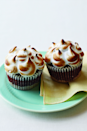 """<p>There's no getting around the fact that these cupcakes take a little leg work, but one bite will prove they're worth it, with a graham cracker and chocolate crust layered with a chocolate cake and finished with fluffy marshmallow topping.</p><p><strong><a href=""""https://www.womansday.com/food-recipes/food-drinks/recipes/a11227/smore-cupcakes-recipe-122601/"""" rel=""""nofollow noopener"""" target=""""_blank"""" data-ylk=""""slk:Get the recipe."""" class=""""link rapid-noclick-resp"""">Get the recipe.</a></strong></p>"""
