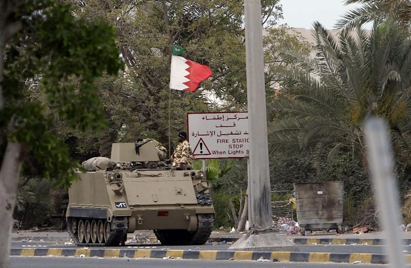 A Bahraini army tank blocks a road leading to Pearl Square in Manama on March 17, 2011 (AFP Photo/Joseph Eid)