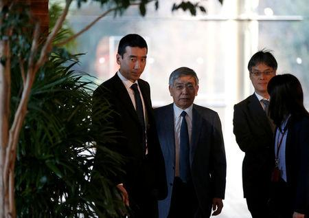 BOJ Governor Kuroda walks after meeting with Japan's PM Abe at Abe's official residence in Tokyo