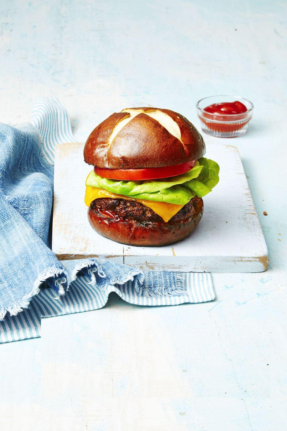 """<p>Give your burgers a kick with the addition of horseradish, spicy mustard and Worcestershire. Then, pair it with a sweet pretzel bun to balance the whole thing out.</p><p><em><a href=""""https://www.goodhousekeeping.com/food-recipes/a38754/deviled-burger-recipe/"""" rel=""""nofollow noopener"""" target=""""_blank"""" data-ylk=""""slk:Get the recipe for Deviled Burger »"""" class=""""link rapid-noclick-resp"""">Get the recipe for Deviled Burger »</a></em> </p>"""