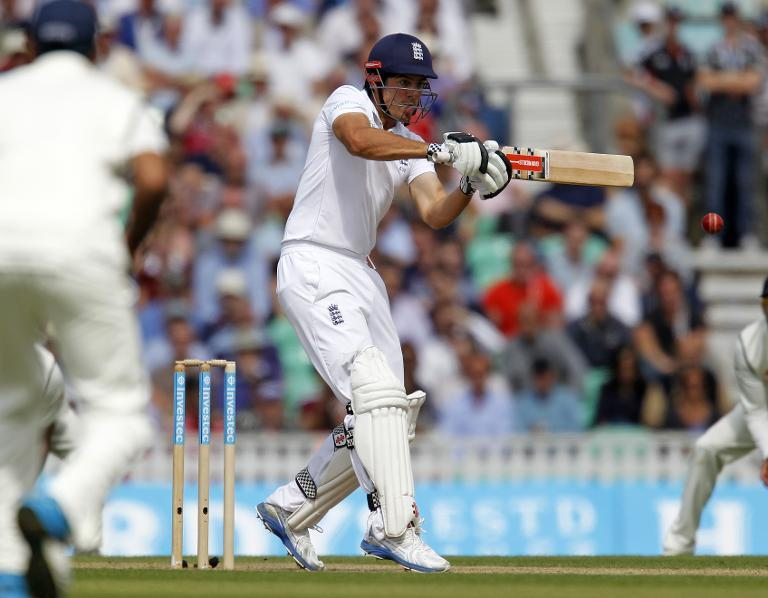 England's captain Alastair Cook hits a boundary during play on the second day of the fifth cricket Test match between England and India at The Oval cricket ground in London on August 16, 2014
