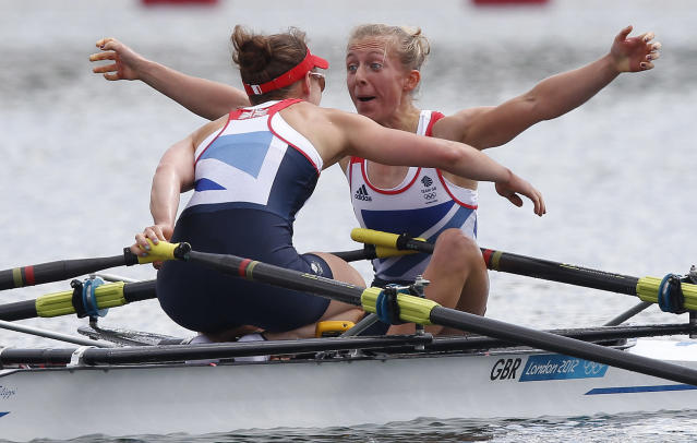 Britain's Katherine Copeland and Sophie Hosking celebrate winning the women's lightweight double sculls final of the rowing event during the London 2012 Olympic Games at Eton Dorney August 4, 2012. REUTERS/Jim Young (BRITAIN - Tags: OLYMPICS SPORT ROWING)