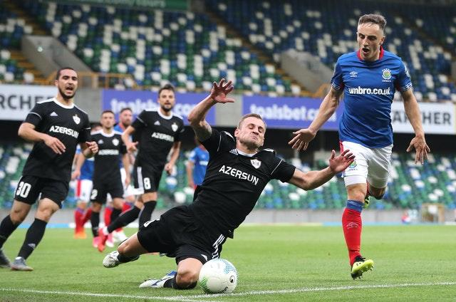 Former Linfield midfielder Joel Cooper, left, has replaced Mark Sykes in Baraclough's squad