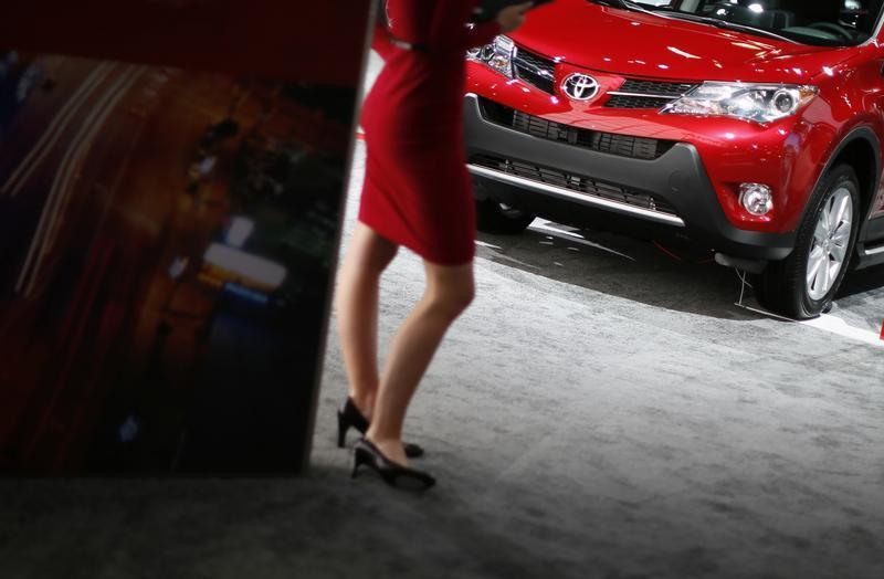A model rocks her stilettos at the Toyota booth at the 2013 Los Angeles Auto Show in Los Angeles