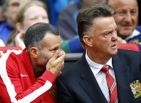 Manchester United's manager van Gaal and his assistant Giggs watch their team during their English Premier League soccer match against Swansea City at Old Trafford in Manchester