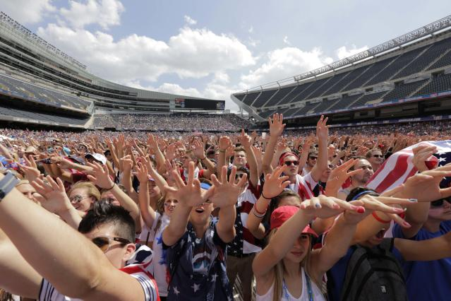 FILE - In this July 1, 2014, file photo, fans cheer for the United States against Belgium during a Brazil 2014 World Cup viewing party at Soldier Field in Chicago. Chicago, the home of the U.S. Soccer Federation, has dropped out of the North American bid for the 2026 World Cup. Organizers were to announce their list of bidding cities Thursday, March 15, 2018. (AP Photo/Stacy Thacker, File)