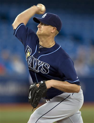 Tampa Bay Rays starting pitcher Alex Cobb throws to the Toronto Blue Jays during the first inning of a baseball game in Toronto on Tuesday, May 21, 2013. (AP Photo/The Canadian Press, Frank Gunn)