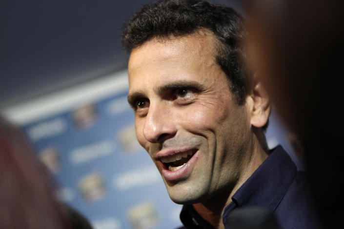 Opposition leader Henrique Capriles smiles after a press conference in Caracas, Venezuela, late Thursday, April 18, 2013. Venezuela's electoral council said Thursday it would audit the 46 percent vote that was not scrutinized election night. Capriles had demanded a full vote-by-vote recount, and has maintained that Sunday's election, which the National Electoral Council had declared won by Hugo Chavez's heir Nicolas Maduro by 262,00000 votes out of 14.9 million cast, was stolen from him through intimidation and other abuses.(AP Photo/Ariana Cubillos)
