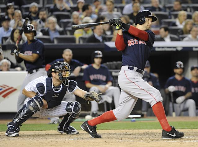 Boston Red Sox batter Grady Sizemore hits a three-run home run as New York Yankees catcher Francisco Cervelli, left, looks on during the sixth inning of a baseball game Friday, April 11, 2014, at Yankee Stadium in New York. (AP Photo/Bill Kostroun)