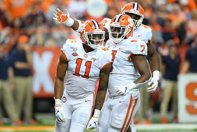 Clemson Tigers linebacker Isaiah Simmons (11) reacts to a defensive play with teammates Justin Mascoll (7) and Xavier Kelly (back) against Syracuse on Saturday. (Getty)