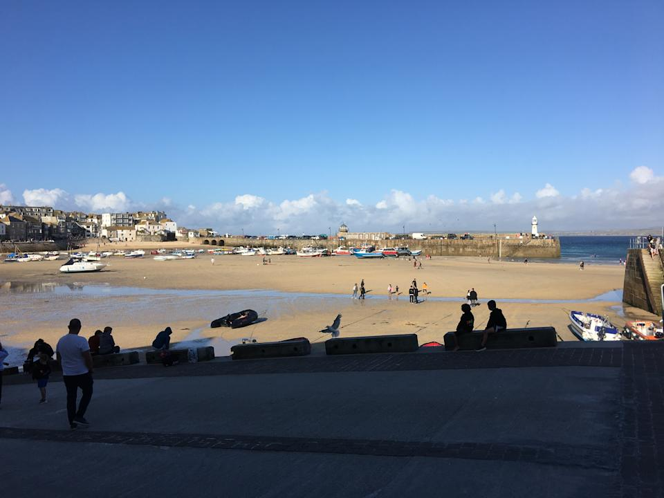 A view of St Ives in Cornwall showing tourist on the beach