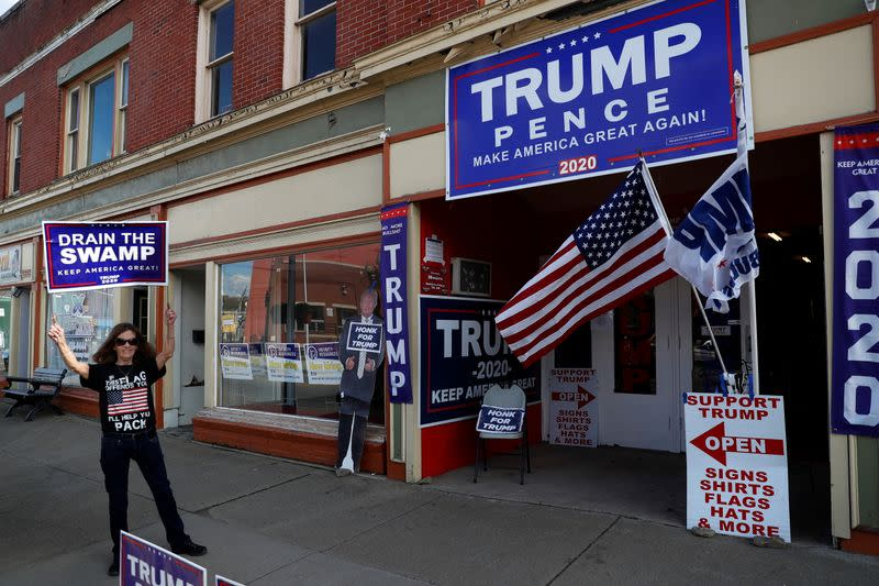A supporter of U.S. President Donald Trump holds a campaign sign outside the Republican headquarters in Union City, Pennsylvania