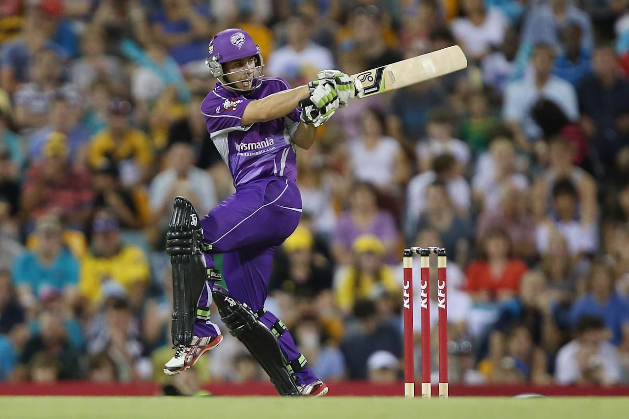 BRISBANE, AUSTRALIA - DECEMBER 09:  Tim Paine of the Hurricanes bats during the Big Bash League match between the Brisbane Heat and the Hobart Hurricanes at The Gabba on December 9, 2012 in Brisbane, Australia.  (Photo by Chris Hyde/Getty Images)