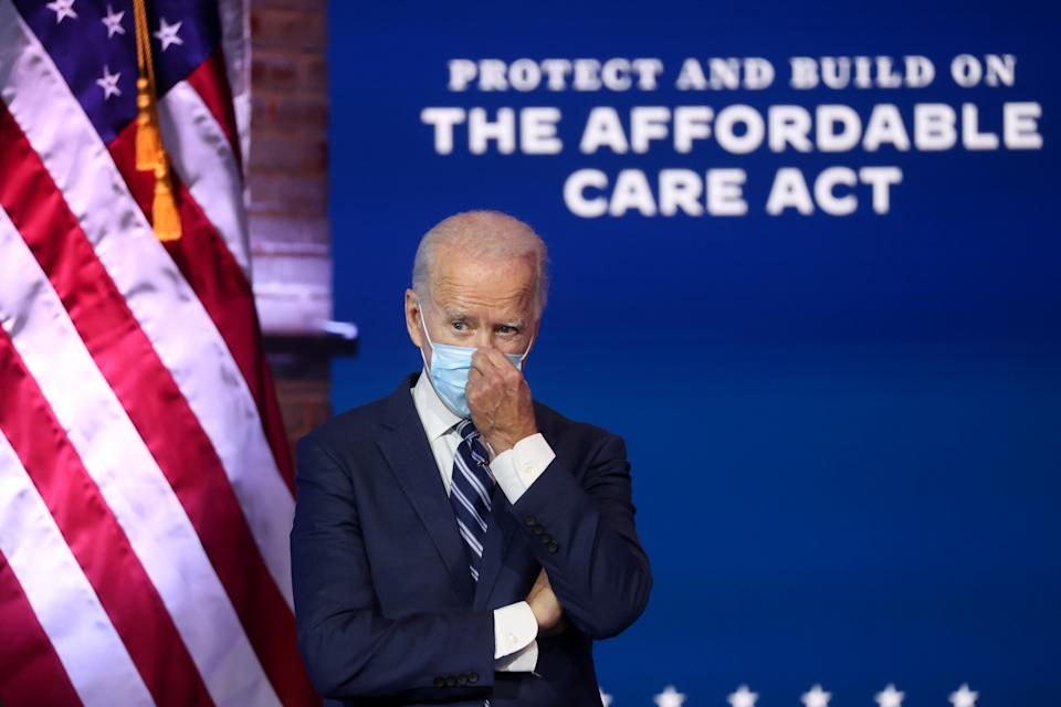 President-elect Joe Biden adjusts his face mask after delivering remarks about health care and the ACA in Wilmington, Delaware, November 10, 2020. REUTERS/Jonathan Ernst