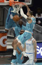 Charlotte Hornets forward Caleb Martin, center, throws down a two-handed dunk against the Los Angeles Lakers during the first half of an NBA basketball game in Charlotte, N.C., Tuesday, April 13, 2021. (Jeff Siner/The Charlotte Observer via AP)