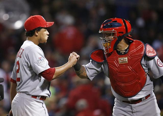 St. Louis Cardinals relief pitcher Carlos Martinez, left, and catcher Yadier Molina react during the seventh inning of Game 2 of baseball's World Series against the Boston Red Sox Thursday, Oct. 24, 2013, in Boston. The Cardinals won 4-2. (AP Photo/Elise Amendola)