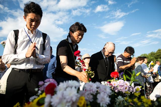 <p>Visitors lays flowers and pray for the atomic bomb victims in front of the cenotaph at the Hiroshima Peace Memorial Park in Hiroshima, western Japan, Sunday, Aug. 6, 2017. (Photo: Richard Atrero de Guzman/NurPhoto via Getty Images) </p>
