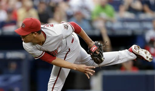 Arizona Diamondbacks pitcher Randall Delgado throws in the first inning of a baseball game against the Atlanta Braves, Friday, June 28, 2013, in Atlanta. (AP Photo/David Goldman)