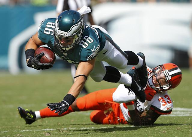 <p>Zach Ertz #86 of the Philadelphia Eagles is tripped up by Jordan Poyer #33 of the Cleveland Browns after making a catch during the third quarter at Lincoln Financial Field on September 11, 2016 in Philadelphia, Pennsylvania. The Eagles defeated the Browns 29-10. (Photo by Rich Schultz/Getty Images) </p>