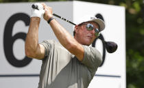 Phil Mickelson plays his shot from the sixth tee during the first round of the Charles Schwab Challenge golf tournament at the Colonial Country Club in Fort Worth, Texas, Thursday, May 27, 2021. (AP Photo/Ron Jenkins)