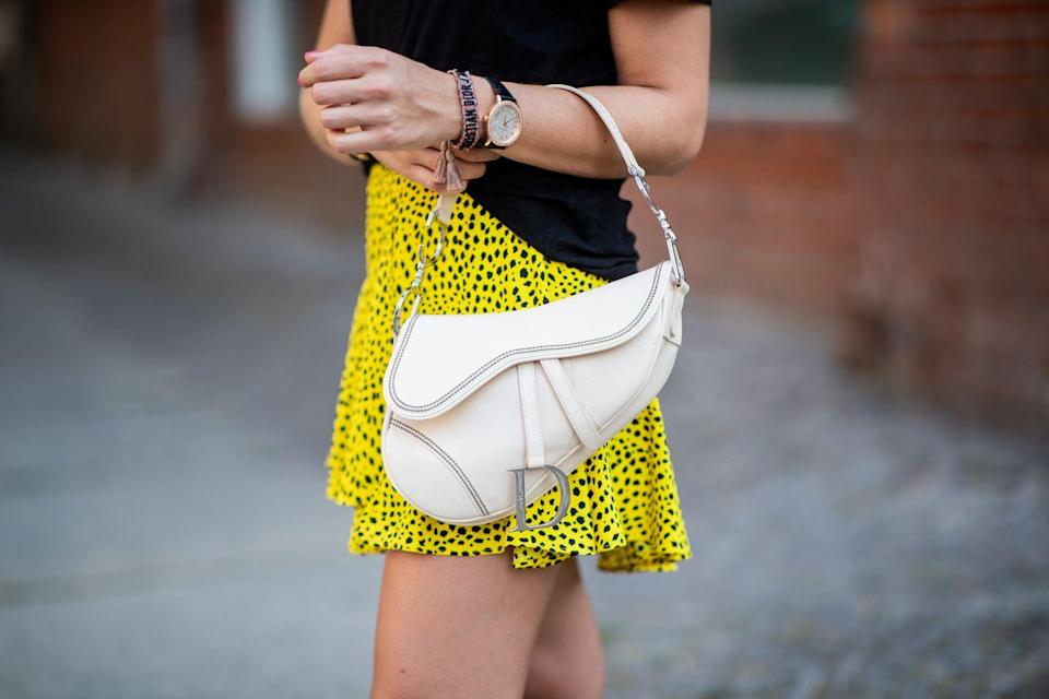 <p>The Western-inspired Dior saddle bag reigned in 2000 (it, too, was in heavy rotation on <em>SATC) </em>and truly was an It Bag for the new millennium. </p>