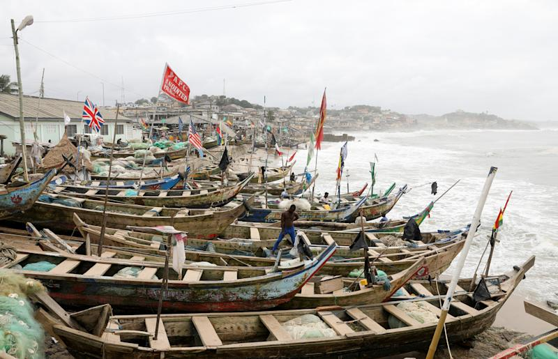 British and American flags are among those hoisted on fishermen's boats at the Cape Coast Castle in Ghana. (Photo: Siphiwe Sibeko/Reuters)