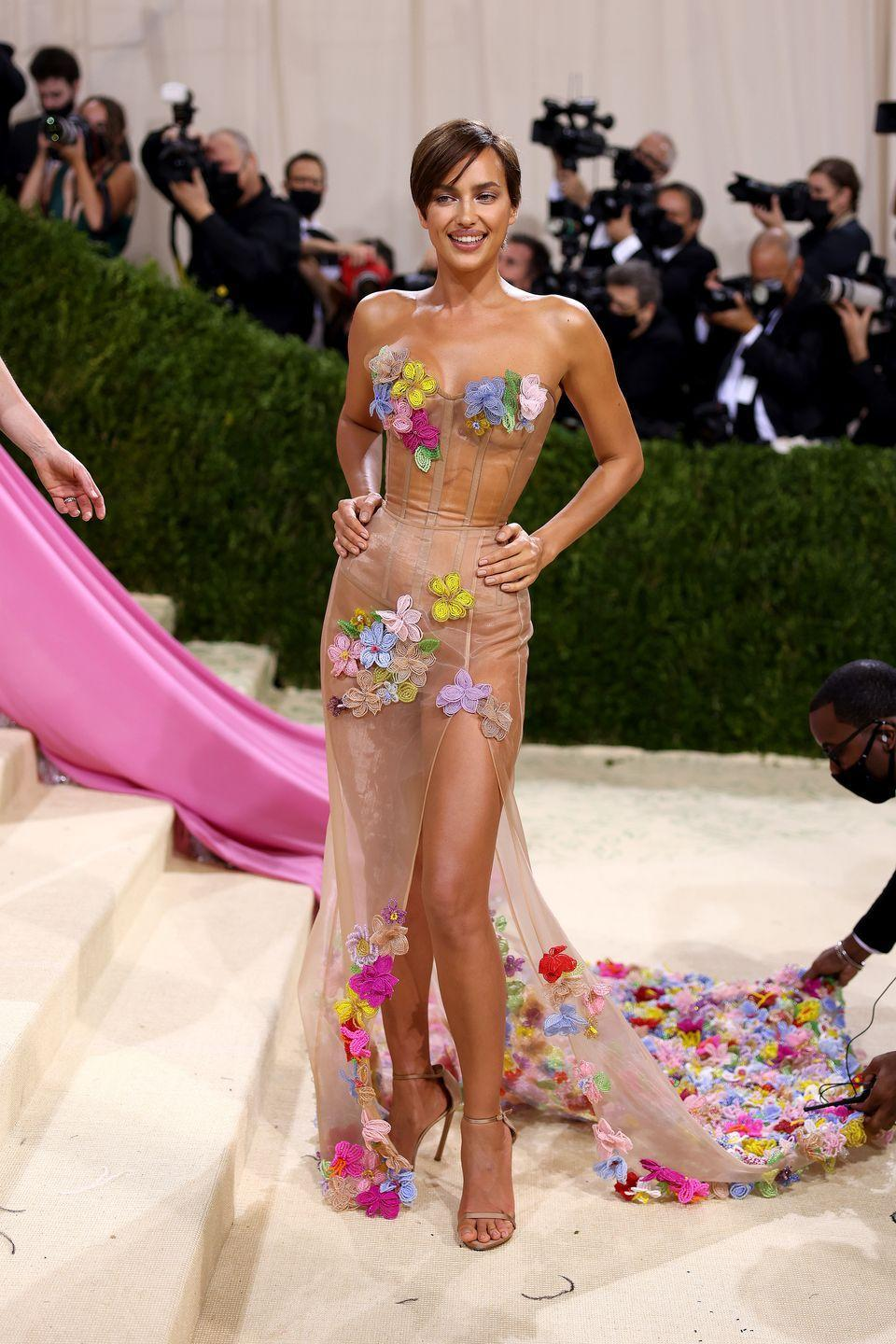 <p>The supermodel wore a sheer floral Moschino gown.</p>