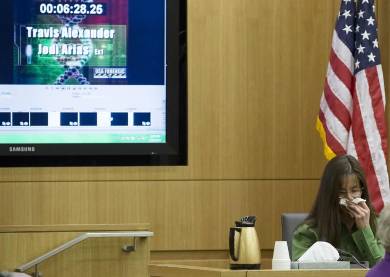 Jodi Arias listens to audio of her and Travis Alexander during a phone call, in Maricopa County Superior Court in Phoenix, Tuesday, Feb. 12, 2013. Arias stands trial accused of murdering her lover, Travis Alexander, in the shower of his Mesa home in 2008. (AP Photo/The Arizona Republic, Mark Henle, Pool)