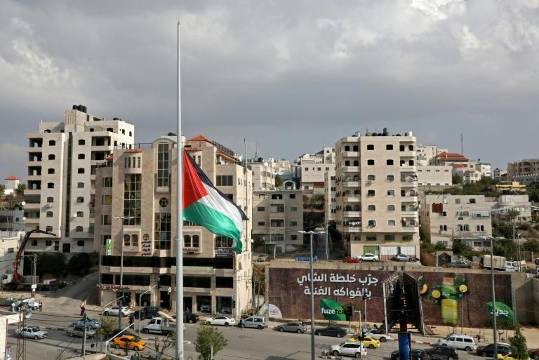 The Palestinian flag flies at half mast in the centre of the West Bank city of Hebron in mourning over the death of Saeb Erekat