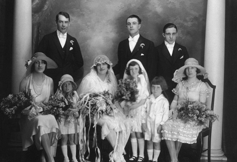 """<p>By the early 20th century, it became customary for bridesmaid dresses to<a href=""""http://www.avictorian.com/weddingattire.html"""" rel=""""nofollow noopener"""" target=""""_blank"""" data-ylk=""""slk:directly contrast with the bride"""" class=""""link rapid-noclick-resp""""> directly contrast with the bride</a>, so the focus would be on her. </p>"""