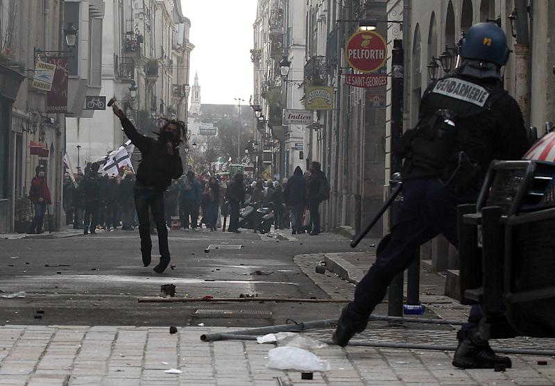 Demonstrators clash against French riot police during a demonstration in Nantes, Saturday, Feb.22, 2014, as part of a protest against a project to build an international airport, in Notre Dame des Landes, near Nantes. The project was decided in 2010 and the international airport should open by 2017. (AP Photo/ Laetitia Notarianni)
