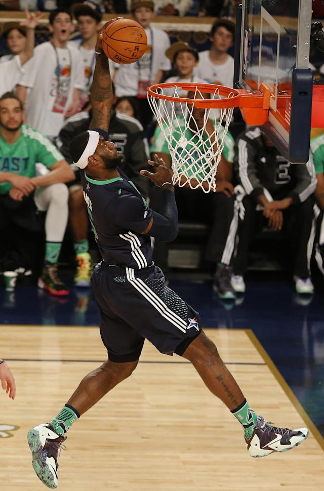 East Team's LeBron James, of the Miami Heat (6) dunks the ball against the West Team during the NBA All Star basketball game, Sunday, Feb. 16, 2014, in New Orleans. (AP Photo/Bill Haber)