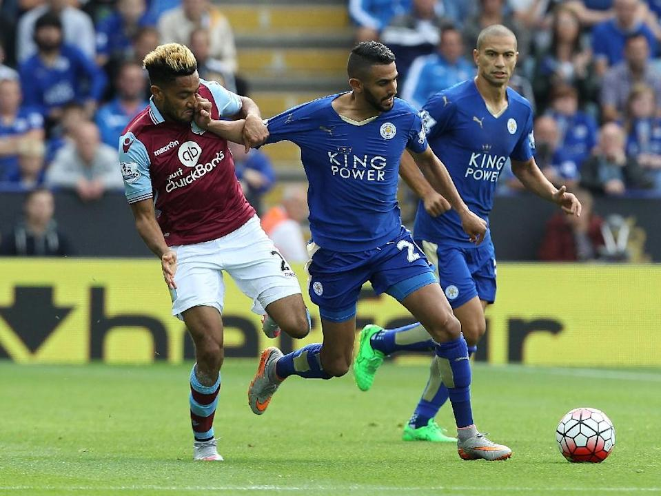 Aston Villa's Jordan Amavi (L) competes for the ball with Leicester City's Riyad Mahrez during their English Premier League match, at King Power Stadium in Leicester, on September 13, 2015 (AFP Photo/Lindsey Parnaby)