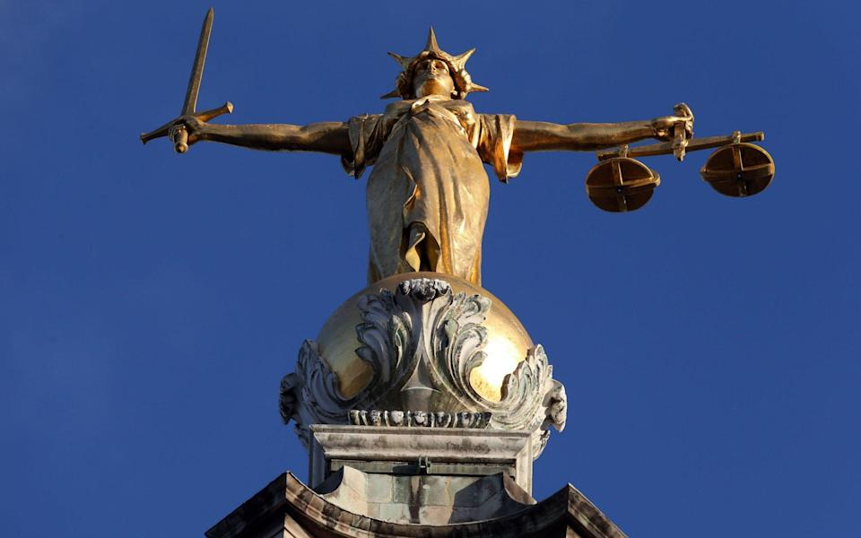 FW Pomeroy's statue of Lady Justice atop the Central Criminal Court at the Old Bailey, London - Jonathan Brady/PA