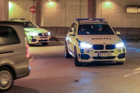 Police cars transporting Philip Manshaus, who is suspected of an armed attack at Al-Noor Islamic Centre Mosque and killing his stepsister arrive at a court in Oslo