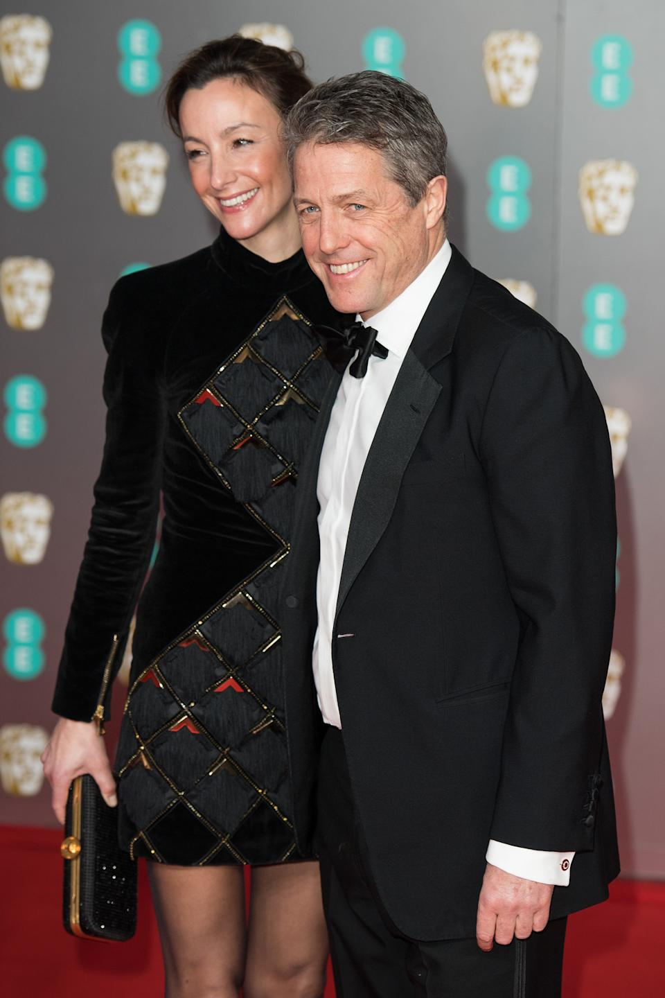LONDON, ENGLAND - FEBRUARY 02: (L-R) Anna Elisabet Eberstein and Hugh Grant attend the EE British Academy Film Awards 2020 at Royal Albert Hall on February 02, 2020 in London, England. (Photo by Jeff Spicer/Getty Images)