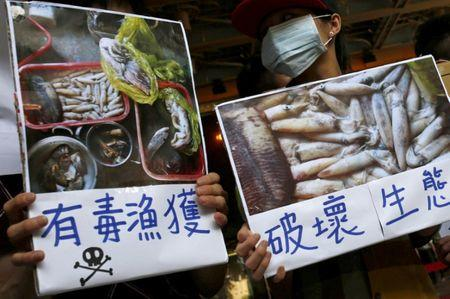 Protesters hold placards during a protest calling for Formosa Plastics to investigate and voluntarily disclose its own findings on massive fish deaths in Vietnam, in Taipei