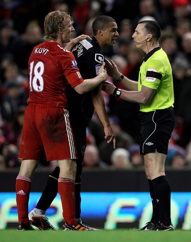 LIVERPOOL, ENGLAND - JANUARY 06:  Tom Adeyemi of Oldham Athletic is restrained after being abused by fans on the Kop during the FA Cup 3rd Round match between Liverpool and Oldham Athletic at Anfield on January 6, 2012 in Liverpool, England.  (Photo by Alex Livesey/Getty Images)