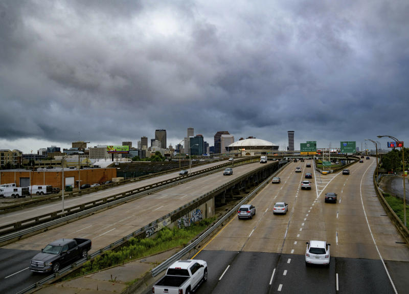 Vehicles make their way on I-10 as bands of rain from Tropical Storm Barry from the Gulf of Mexico move into New Orleans, La., Friday, July 12, 2019. (Photo: Matthew Hinton/AP)