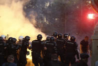 Serbian riot police clashes with protesters in Belgrade, Serbia, Wednesday, July 8, 2020. Serbia's president Aleksandar Vucic backtracked Wednesday on his plans to reinstate a coronavirus lockdown in Belgrade after thousands protested the move and violently clashed with the police in the capital. (AP Photo/Darko Vojinovic)