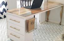 """<p>A plexiglass-covered core door now sits atop the dresser and a pair of table legs, creating the perfect stylish workspace. The bare dresser got a coordinating upgrade with a fresh coat of paint and new pulls.</p><p>See more at <a href=""""http://addisonmeadowslane.com/ikea-rast-hack-new-craftroom-desk/"""" rel=""""nofollow noopener"""" target=""""_blank"""" data-ylk=""""slk:Addison Meadows Lane"""" class=""""link rapid-noclick-resp"""">Addison Meadows Lane</a>.</p><p><em><a class=""""link rapid-noclick-resp"""" href=""""https://www.amazon.com/Rust-Oleum-206999-Marine-Topside-1-Quart/dp/B000BZTJT2/?tag=syn-yahoo-20&ascsubtag=%5Bartid%7C2089.g.29514474%5Bsrc%7Cyahoo-us"""" rel=""""nofollow noopener"""" target=""""_blank"""" data-ylk=""""slk:BUY NOW"""">BUY NOW</a> <strong>White Paint $15, <span class=""""redactor-unlink"""">amazon.com</span></strong></em></p>"""