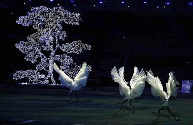 Dancers perform during the closing ceremony of the 2014 Winter Olympics, Sunday, Feb. 23, 2014, in Sochi, Russia. (AP Photo/Charlie Riedel)