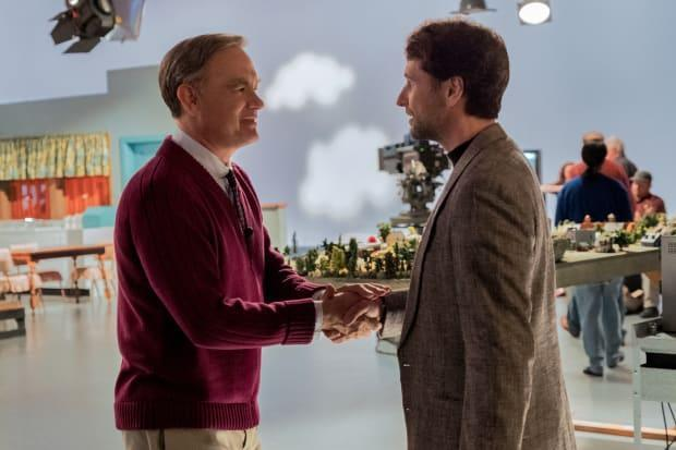 """Fred Rogers (Tom Hanks) welcomes reporter Lloyd (Matthew Rhys) to the """"Mister Rogers' Neighborhood"""" set. Photo: <em>Lacey Terrell/Courtesy of Sony Pictures Entertainment</em>"""